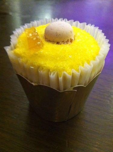 bottega louie lemon chiffon cupcake with mini macaron