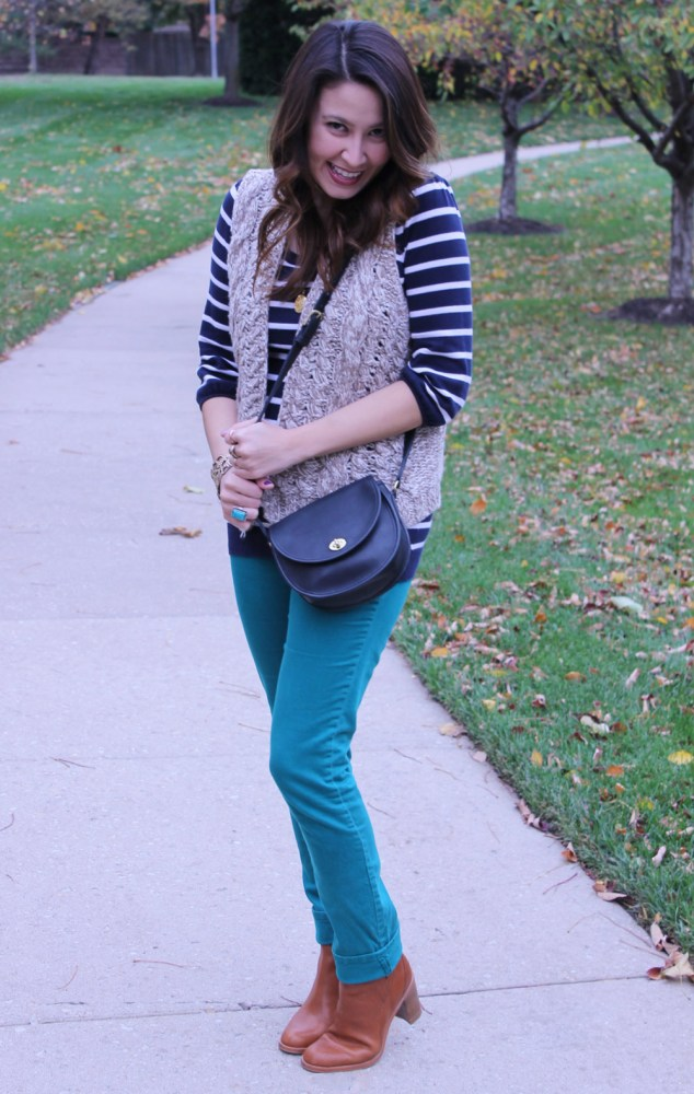 navy striped shirt and teal jeans