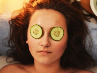 girl with cucumbers on eyes