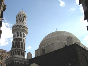 A minaret rises above a mosque in Sanaa. Traditionally an imam stood in the minaret for the call to prayer. Now it is broadcast through speakers mounted inside the tower.