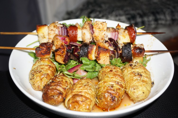 Chicken chorizo halloumi kebabs with salad and baked hassle back potatoes