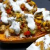 Baked Mexican style sweet potatoes with fajita style chicken, cheddar cheese and sour cream