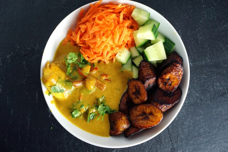Haddock in a coconut based gluten free curry sauce with fried plantains,c carrot and cucumber