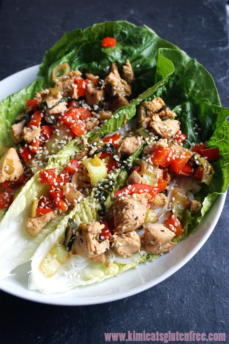 Gluten free Thai chicken pak choi lettuce wraps with sesame seeds sprinkled on top.