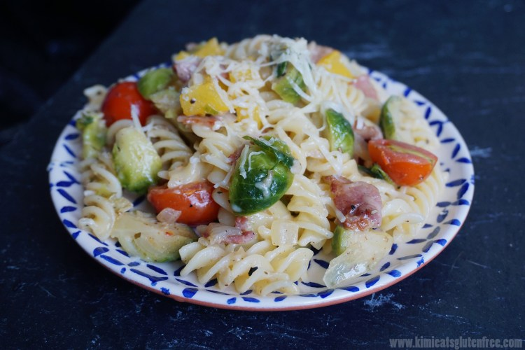 Gluten free breakfast pasta with cheese, bacon and vegetables