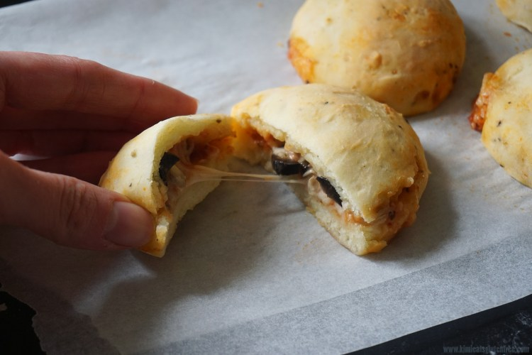 Gluten free hot pockets filled with pepperoni, cheese, black olives and a basic homemade pizza sauce