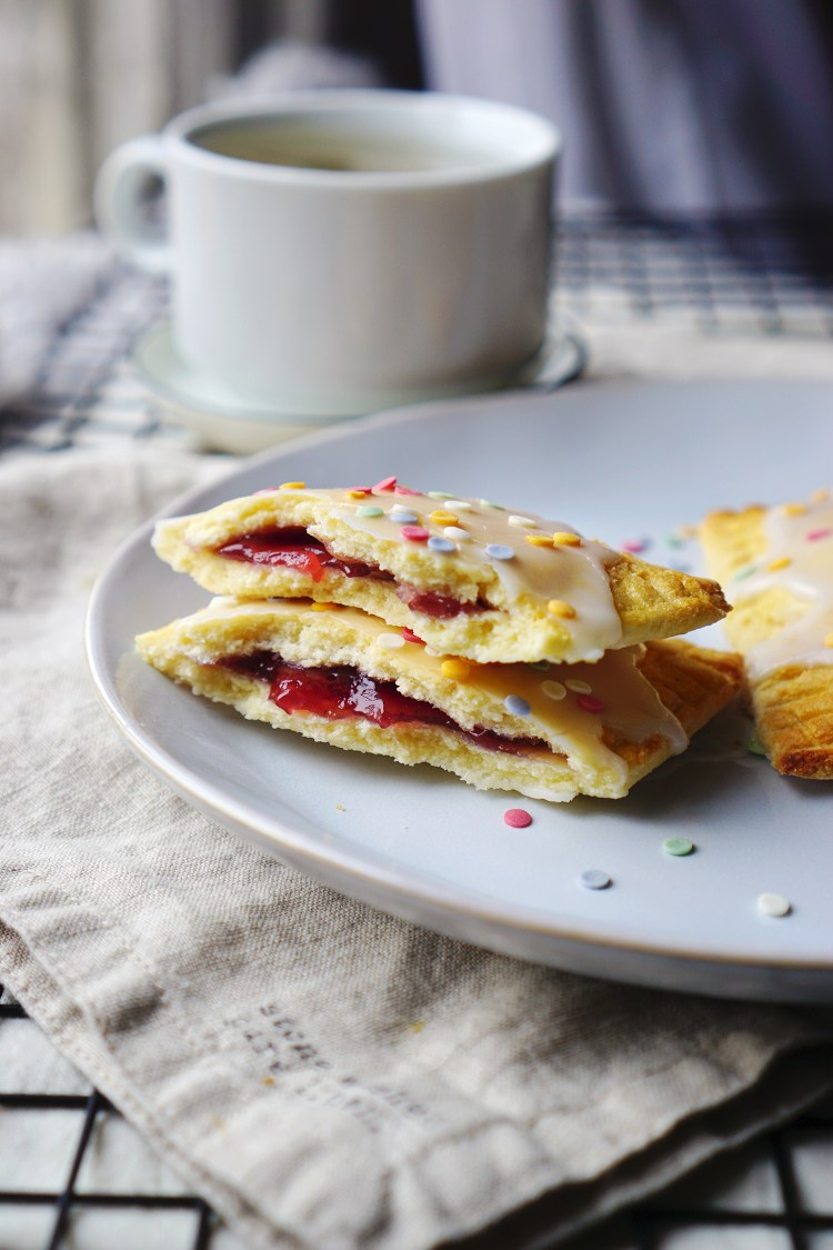Homemade gluten free pop tarts made with a low carb coconut shortcrust pastry and decorated with icing and Waitrose fruity confetti.