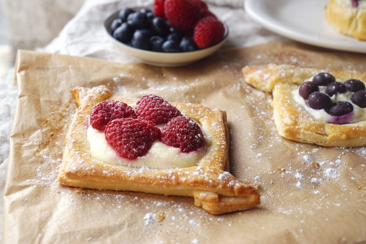 Gluten free cream cheese and raspberry Danish pastries made with a quick puff pastry alternative
