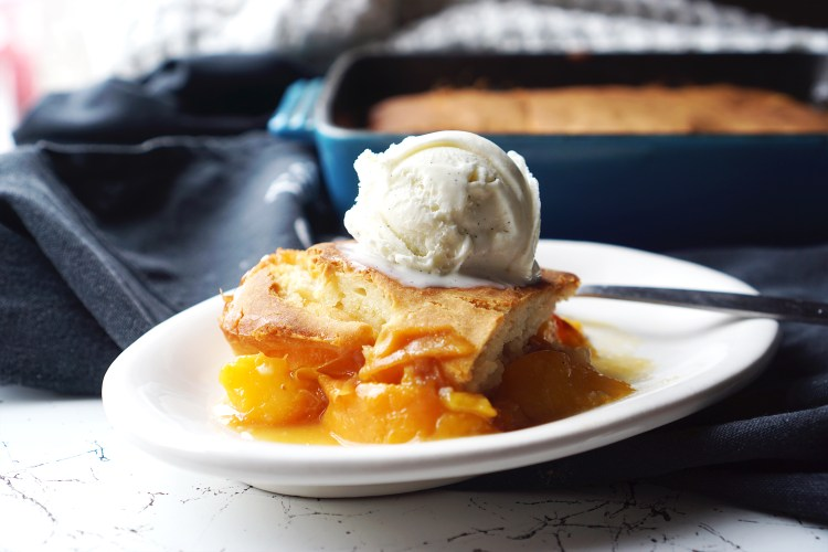 Homemade gluten free peach cobbler topped with vanilla ice cream