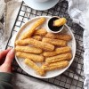 Homemade gluten free churros with a simple caramel sauce to dip