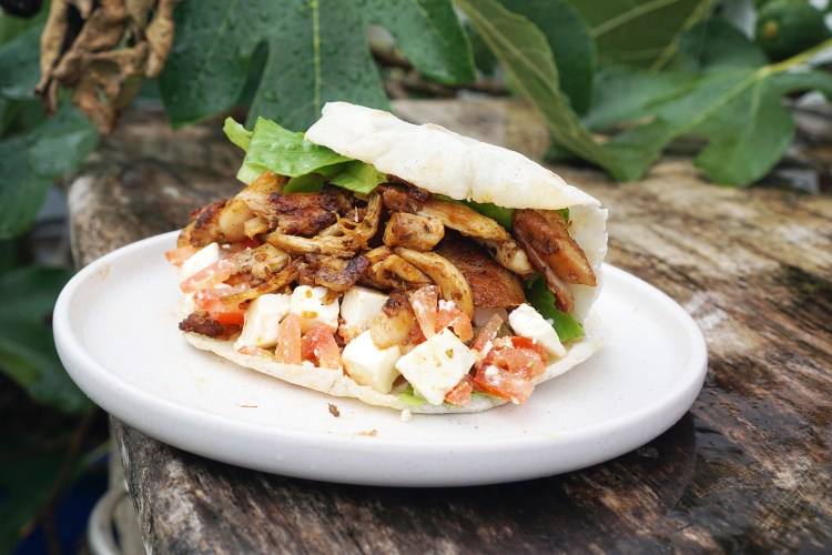 Chicken doner kebabs filled with kebab style meat, tomato, feta, lettuce, yoghurt sauce + homemade gluten free pita bread