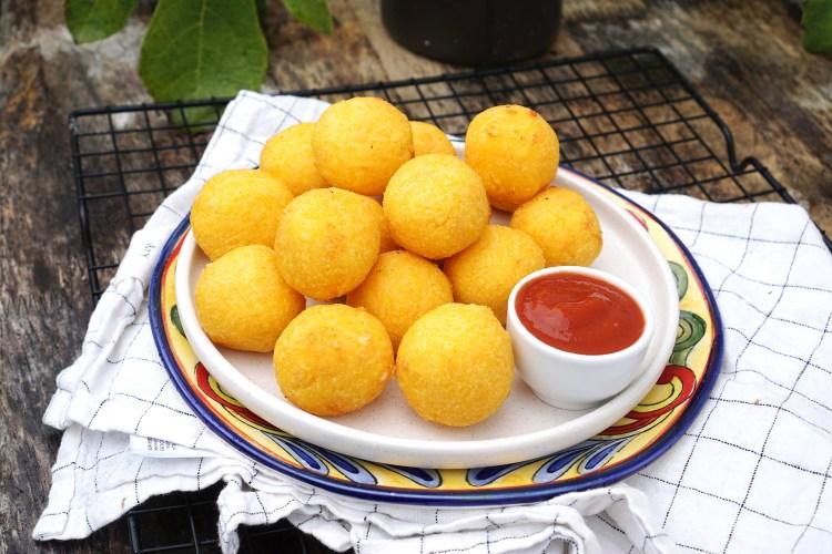 Little gluten free cheesy corn dough balls / arepa cheese balls with salsa to dip | Colombian / Venezuelan food