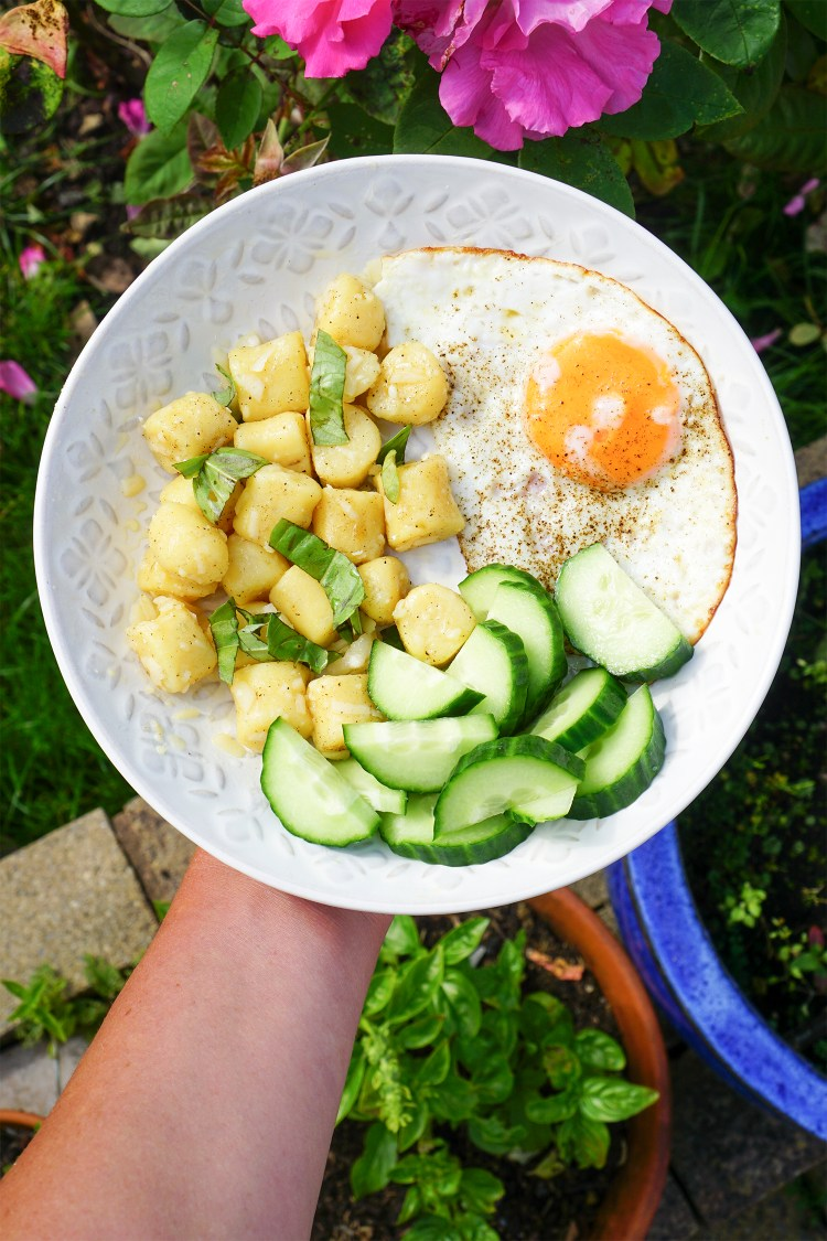 Gluten free grain free gnocchi made with potato and fufu + garlic butter, fresh basil, cucumber and a fried egg / gluten free brunch