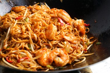 Gluten free spicy wok fried gochujang noodles with prawns, garlic, ginger, chilli and spring onions