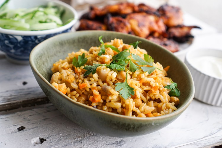Easy Turkish chickpea rice with onion, carrot, garlic. Served with lemon juice and fresh parsley on top.