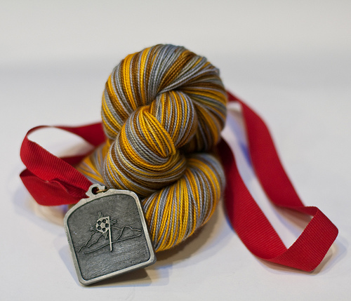 win a hank of Olympic Medals Yarn!