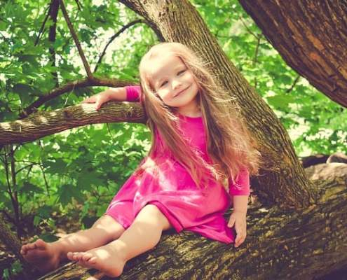 girl smiling in tree