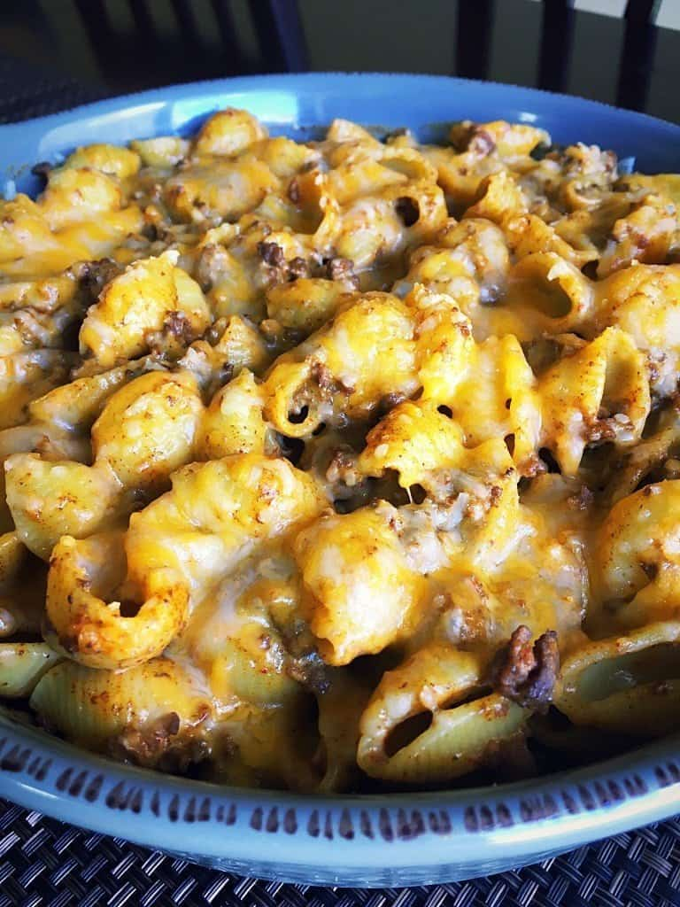 Looking for a quick pasta recipe the whole family will love?  Try my Easy and Delicious Weeknight Taco Pasta recipe that features creamy taco pasta with beef, cheese, and taco seasoning.