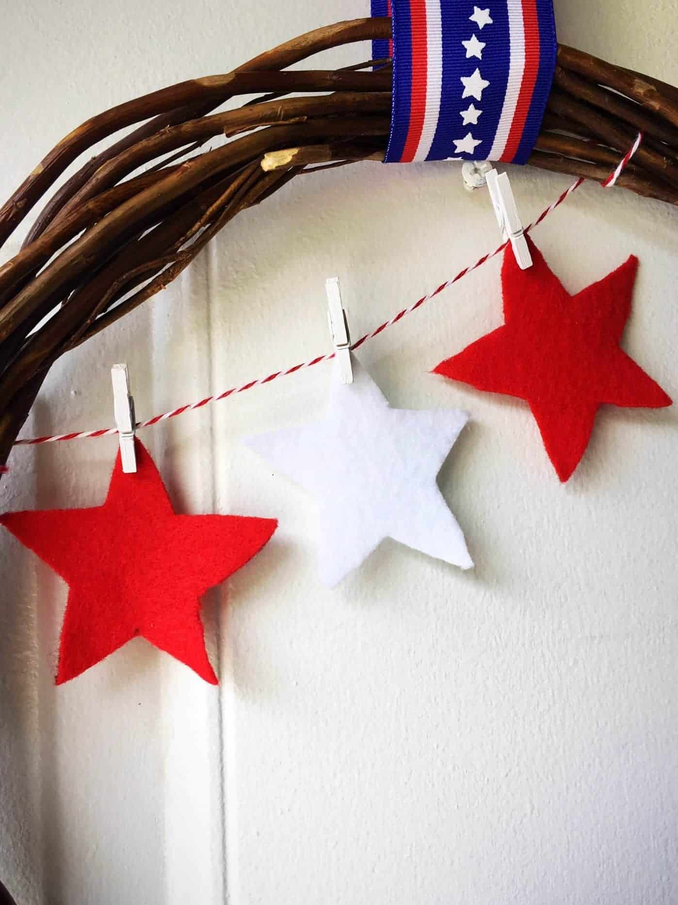 Looking for an easy DIY to dress up your front door decor for the 4th of July? Check out my step-by-step tutorial on how to make a patriotic Fourth of July Pinwheel Wreath featuring a grapevine wreath, gorgeous red, white, and blue felt pinwheels, and a stars and stripes ribbon. #fourthofjulycraft #4thofjulycraft #fourthofjulywreath #patrioticcraft #fourthofjuly #redwhiteandblue #easywreath