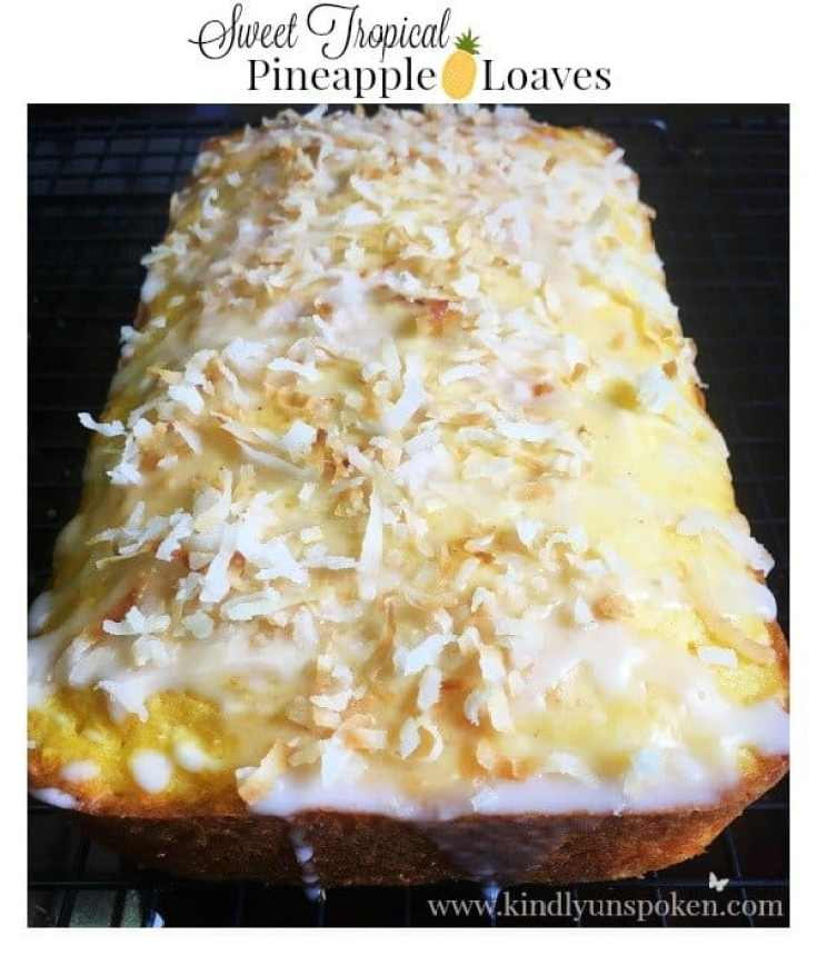 Sweet Tropical Pineapple Loaves -Sail away to a tropical island with these easy and delicious sweet tropical pineapple loaves, topped with a sweet glaze and toasted coconut.