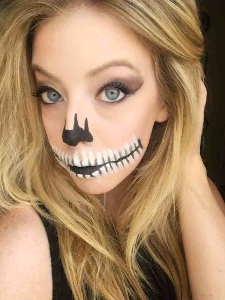 Skeleton Mouth Makeup-These 5 Pretty + Easy Halloween Makeup Looks will inspire you to get creative with your makeup this year for Halloween. From pretty and girly to spooky and scary, these makeup looks are perfect for wearing to all your Halloween parties!