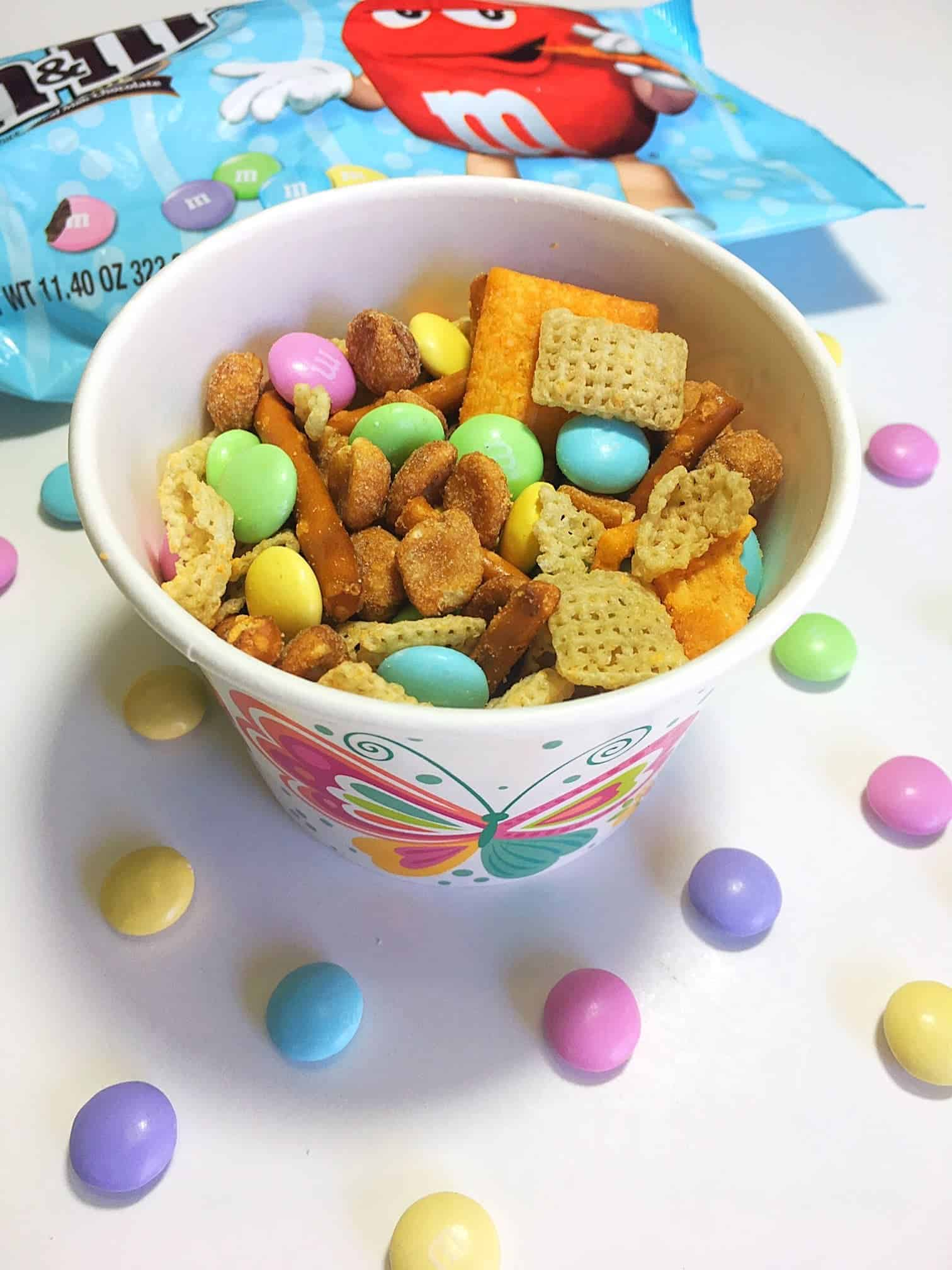 Sweet & Salty Spring Chex Mix-Whether you're craving something sweet or salty, this easy to make Sweet & Salty Spring Chex Mix features both flavors that'll leave you completely satisfied. Plus it only takes 5 minutes to whip together and is perfect for serving to family and friends!