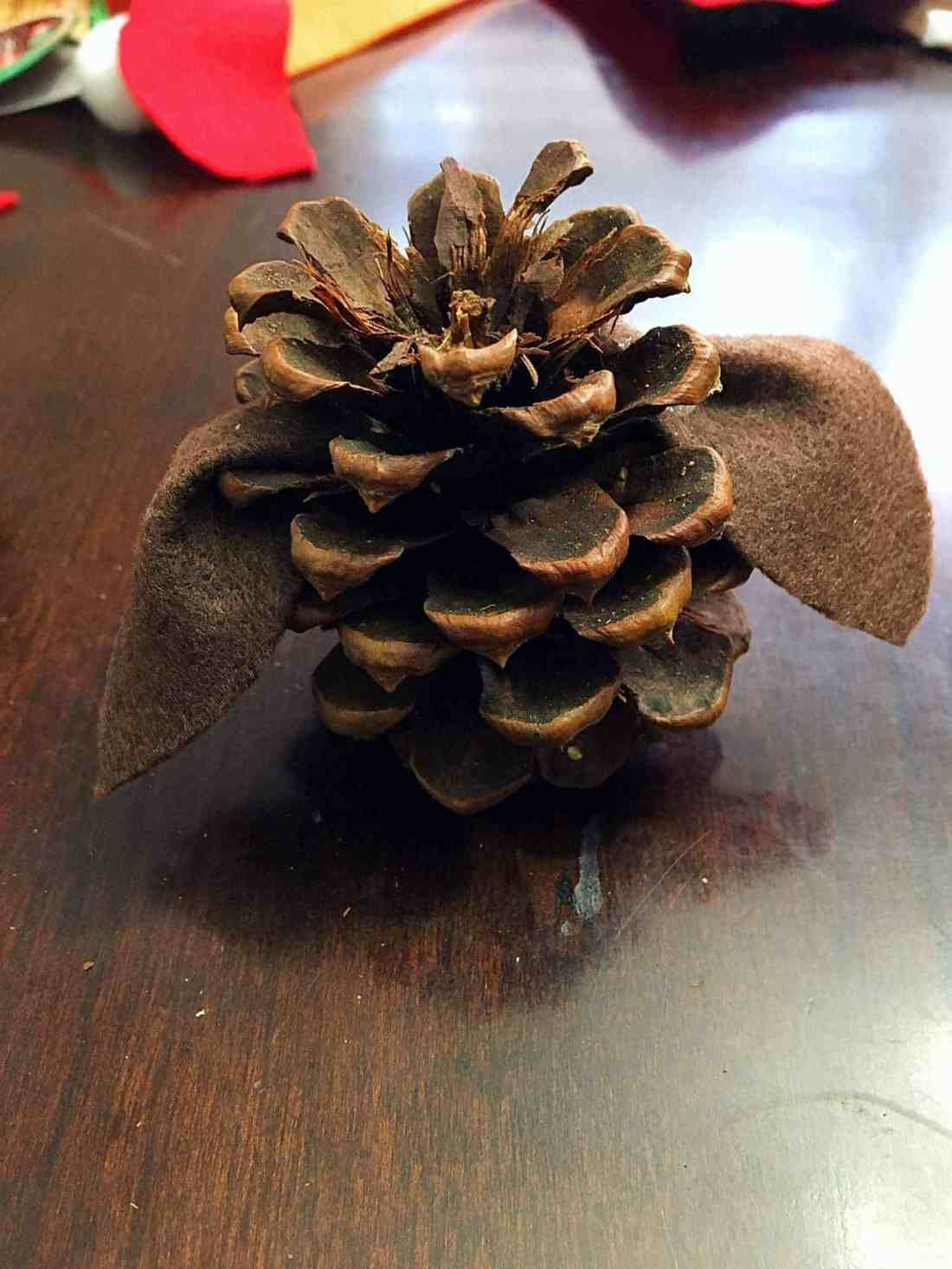 Easy + Adorable Kid's Pinecone Christmas Ornaments - These adorable pinecone christmas ornaments are so easy to create and the perfect craft to make with your kids this year!