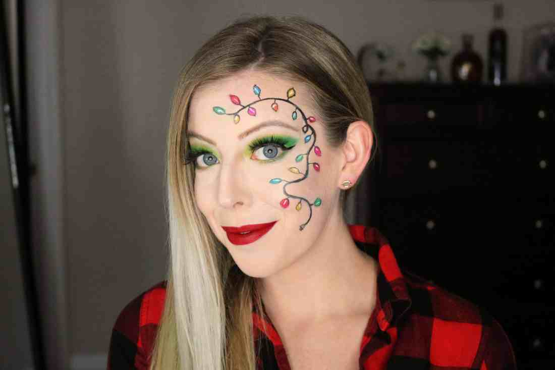Leave the boring makeup looks at home for your next Christmas party and try this gorgeous and festive string lights Christmas party makeup look, featuring colored Christmas lights! Head on over to get the full details on how to create this Christmas lights makeup! #christmasmakeup #holidaymakeup #christmasparty #christmaslights
