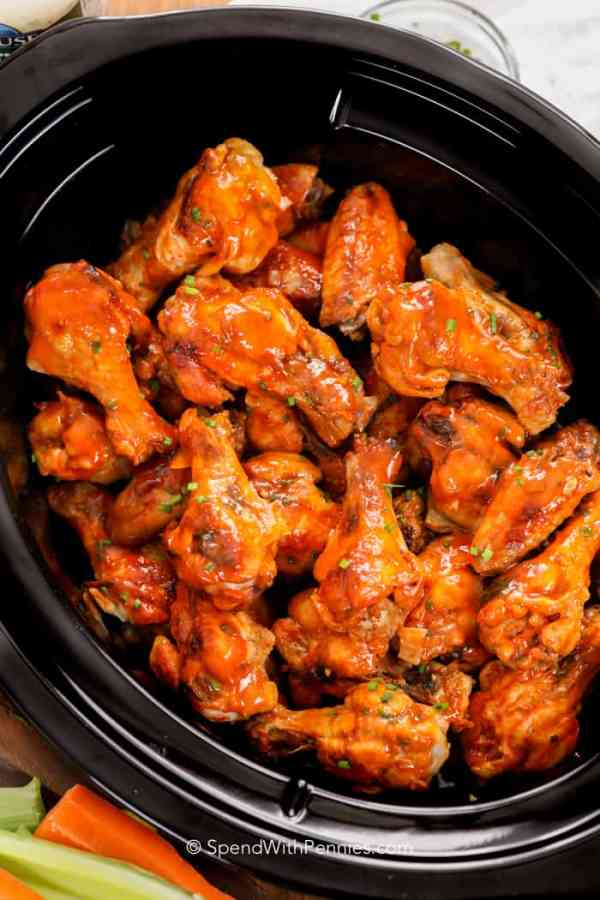 Easy Crockpot Chicken Wings | Need food recipe ideas that everyone will love to eat at your next Super Bowl party? Check out my roundup of the 65 Best Super Bowl Party Food Recipes including easy and delicious appetizers, wings, dips, snacks, desserts, and more! #superbowl #partyfood #superbowlfood