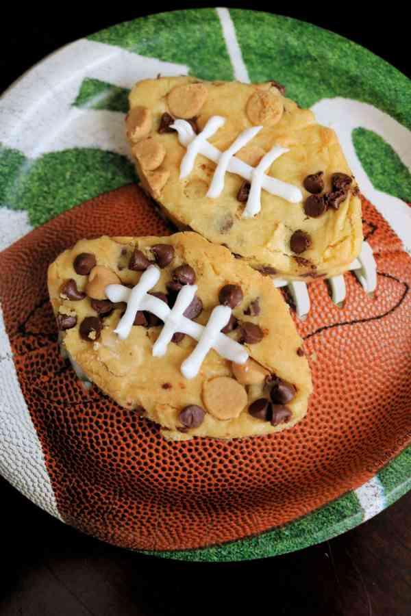 Peanut Butter Chocolate Chip Football Blondies | Need food recipe ideas that everyone will love to eat at your next Super Bowl party? Check out my roundup of the 65 Best Super Bowl Party Food Recipes including easy and delicious appetizers, wings, dips, snacks, desserts, and more! #superbowl #partyfood #superbowlfood