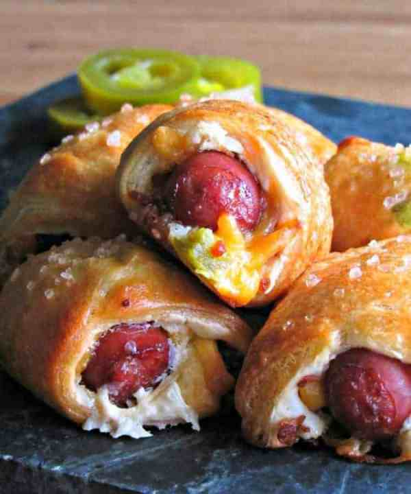 Jalapeño Popper Pigs in A Blanket | Need food recipe ideas that everyone will love to eat at your next Super Bowl party? Check out my roundup of the 65 Best Super Bowl Party Food Recipes including easy and delicious appetizers, wings, dips, snacks, desserts, and more! #superbowl #partyfood #superbowlfood