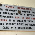 Enamel sign for a Novox respirator, from a paper mill.