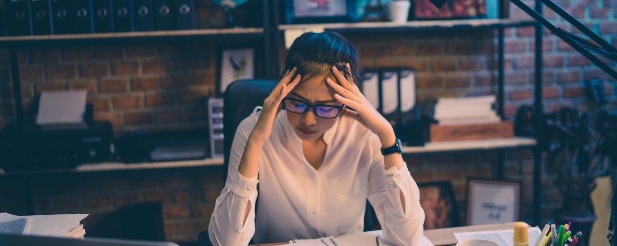 women are stressed out of work. She is in the office at night