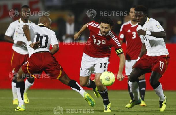 "Hossam Ghali (C) of Egypt fights for the ball with Sulley Muntari (R) and Andre Ayew of Ghana during their 2014 World Cup qualifying second leg playoff soccer match at Air Defence ""30 June"" stadium in Cairo November 19, 2013. REUTERS/Amr Abdallah Dalsh (EGYPT - Tags: SPORT SOCCER WORLD CUP)"