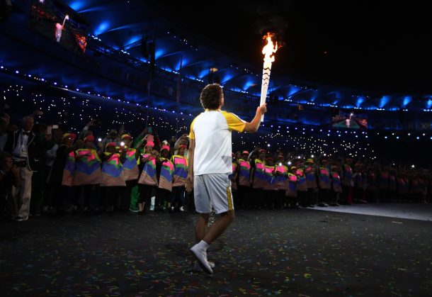 Former Brazilian tennis player Gustavo Kuerten carries the Olympic Torch during the Opening Ceremony of the Rio 2016 Olympic Games at Maracana Stadium on August 5, 2016 in Rio de Janeiro, Brazil. (Photo by Cameron Spencer/Getty Images)