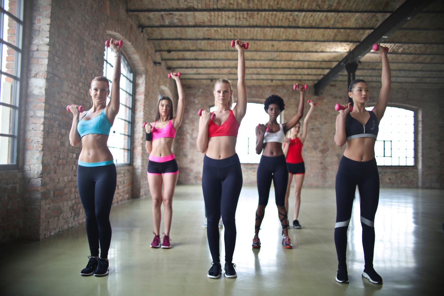 picture of a group of women exercising a form of overcoming stress