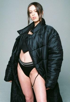 Gina Wagstaffe wears Top and Bikini Bottoms - Nasir Mazhar from Distal Phalanx | Puffer Jacket - Walter Van Bierendonck from dotCOMME | Earrings - Ella Maximillion