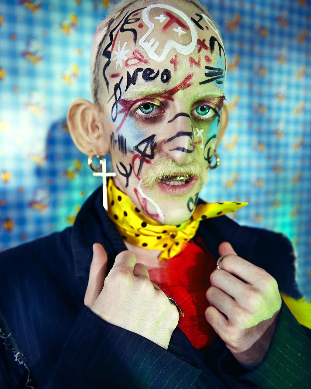 Rings - Peter Said | Earrings - Model's own | Suit - Custom Neocamp