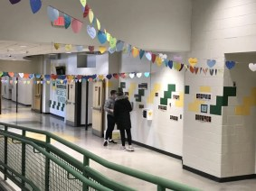 Students in KP Cares and the Student Council were given 10 hearts to decorate with the names of 10 seniors, which were then strung up across the lobby on display. (Photo courtesy King Philip Regional School District)