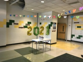 The King Philip Regional High School bus loop lobby was also decorated with seniors' freshmen yearbook photos taped to the walls and 2021 balloons. (Photo courtesy King Philip Regional School District)