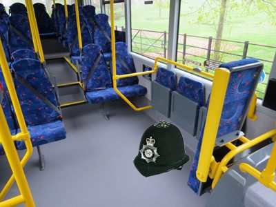 Picture of a policeman's helmet in a bus wheelchair space
