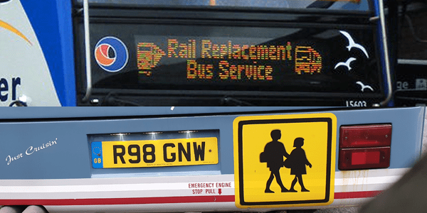 A Rail Replacement Bus and School Bus sign