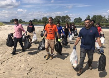City Council Candidate Steven Patzer, center, with volunteers claned up Coney Island Creek yesterday. Contributed Photo.