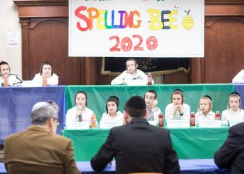 Assemblyman Simcha Eichenstein judges at the 16th annual Spelling Bee at the Krasna Cheder in Borough Park in Brooklyn, New York on Thursday, January 30, 2020.    CREDIT: Benjamin Kanter