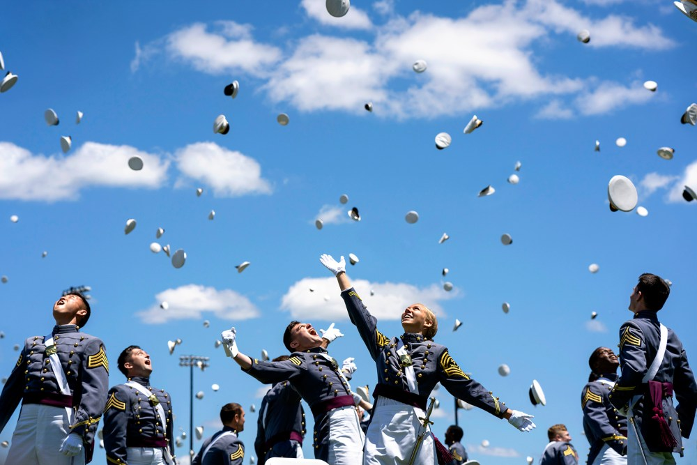 Cadets toss their hats into the air after their graduation and commissioning ceremony at the academy in West Point, N.Y. (Photo by Tsubasa Berg)