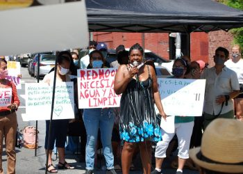 Organizer Karen Blondel leads NYCHA residents in a chant to improve public housing conditions. Photo by Ariama C. Long