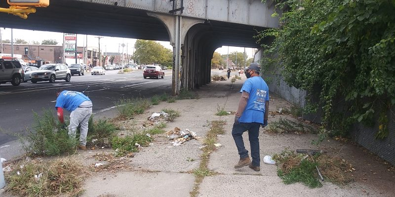 """City Council 45th District Candidate Anthony Beckford and his """"Not In My Backyard Community Cleanup"""" team on Utica Avenue. Contributed Photo."""
