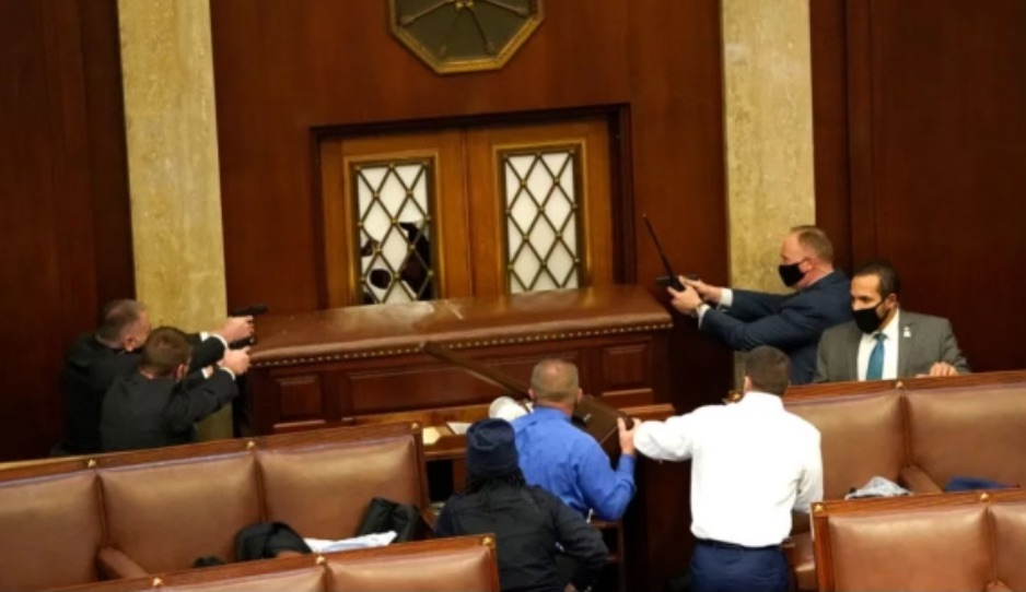 Law enforcement barricade the door to the Senate floor to keep Pro-Trump protesters out. (Contributed photo)