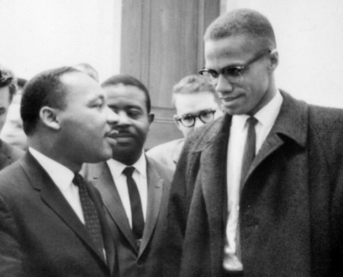 Martin Luther King, Jr., left, and Malcolm X, right, meet before a press conference. Both men had come to hear the Senate debate on the Civil Rights Act of 1964. This was the only time the two men ever met; their meeting lasted only one minute. The photo is part of a collection donated to the Library of Congress. Per the deed of gift, U.S. News & World Report dedicated to the public all rights it held for the photographs in this collection upon its donation to the Library.