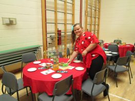 Setting up the tables, a raffle ticket under each plate.